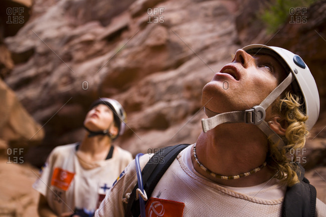 Adventure racers looking up from a canyon after rappelling in a race in Moab Utah.