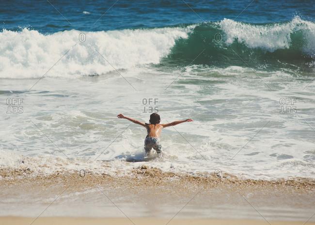Boy splashing around in the ocean