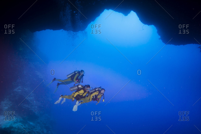 Two scuba divers in underwater cave