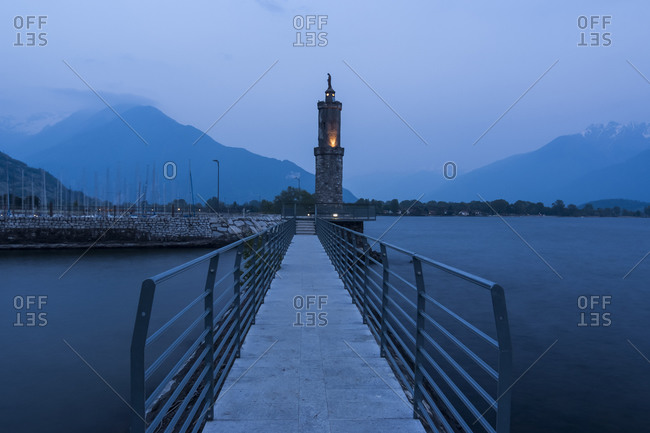 Harbor with Madonna statue in the evening