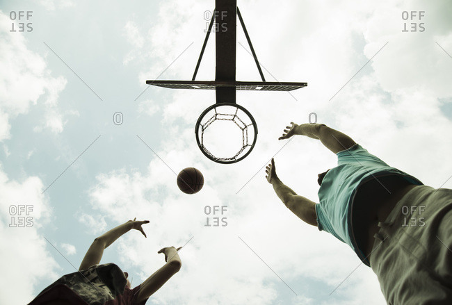 Father and son playing basket ball