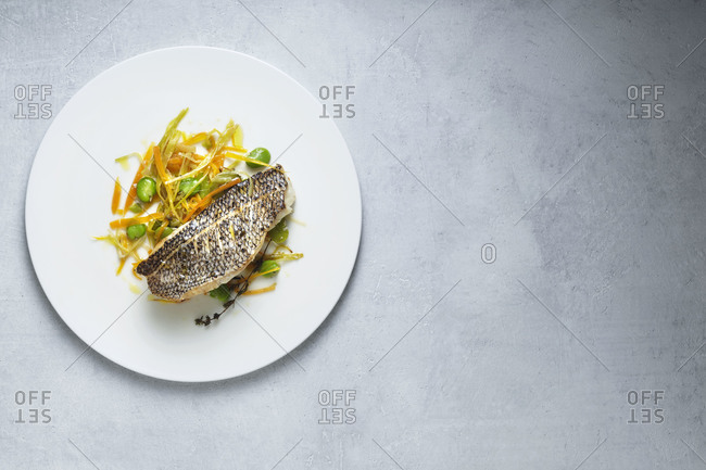 Cannabis lemon grilled sea bass with julienned vegetables