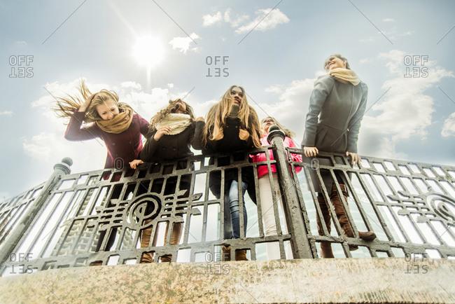 Women leaning over banister