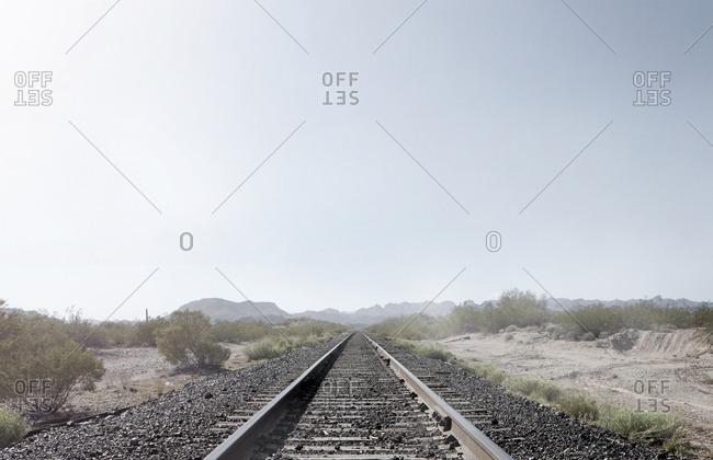 Train tracks in dusty rural landscape