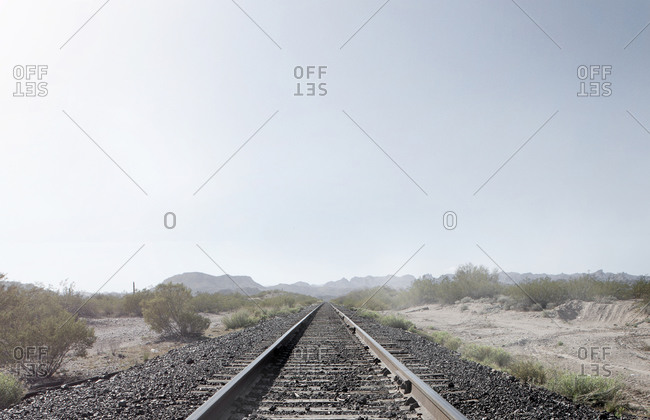 Train tracks in dusty rural landscape