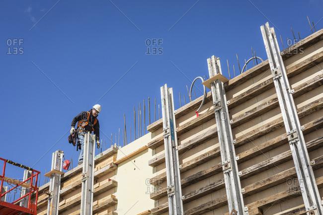 Caucasian worker walking on concrete wall form