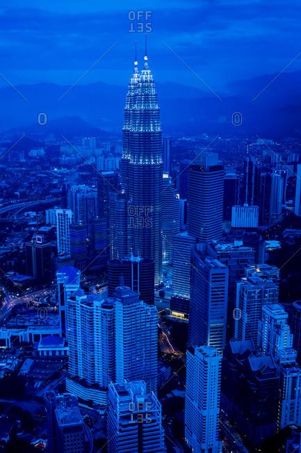 Kuala Lumpur, Malaysia - February 16, 2013: View of city skyline lit up at night, Kuala Lumpur, Malaysia