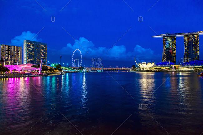 Singapore city skyline lit up at night, Singapore, Republic of Singapore