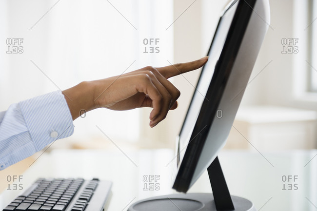 Mixed race businesswoman working on touch screen computer