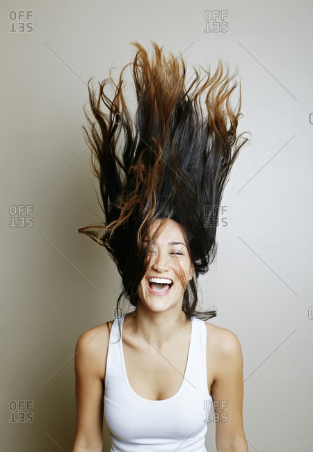 Mixed race woman tossing her hair