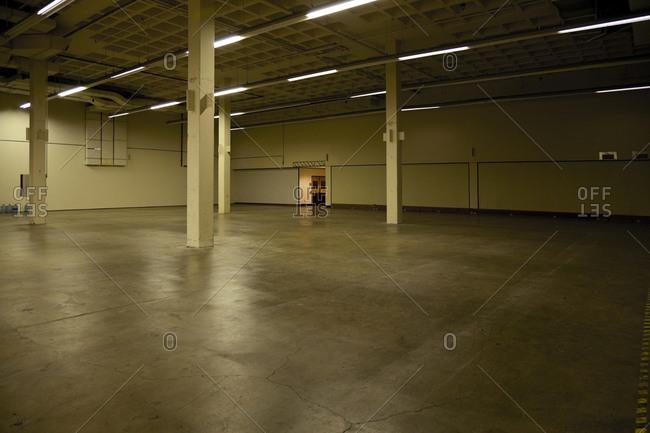 Pillars and lighting in empty warehouse
