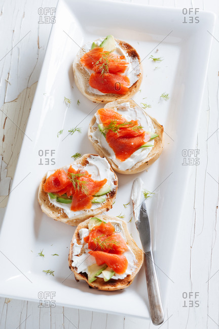 Bagels with cream cheese and lox served on a platter