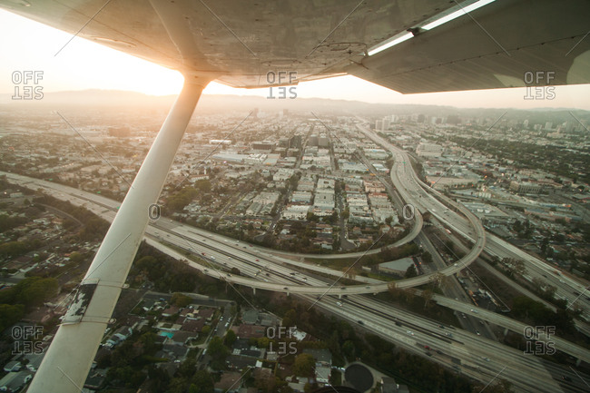 View of an airplane above freeways in Los Angeles, USA