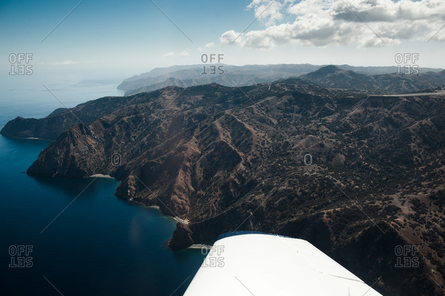 View of an airplane wing above Catalina Island, California