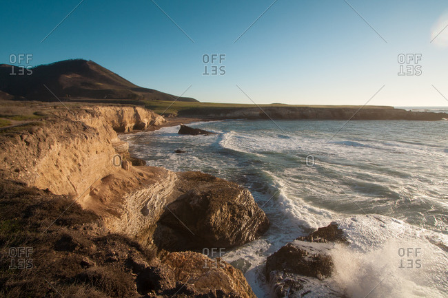 Breaking ocean waves on a coast