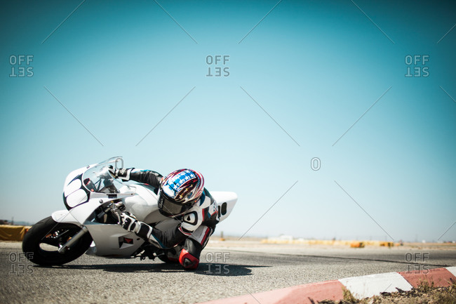 Motorcyclist taking a sharp turn on a race track