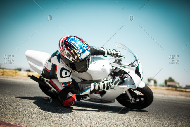 Close up of biker taking a sharp turn on a race track