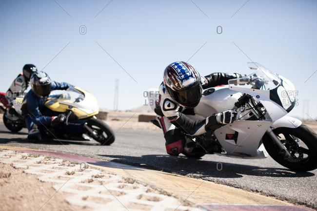 Bikers taking a sharp turn on a race track