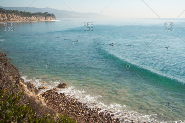 High angle view of surfers at Point Dume State Beach, USA