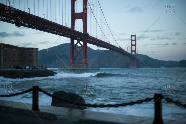 Surfing in front of the Golden Gate Bridge, San Francisco, USA