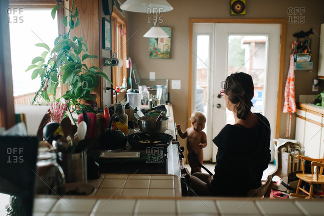 Mother with her child in a kitchen