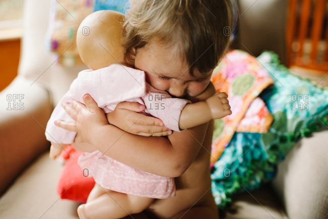 Little girl  holding tight her toy