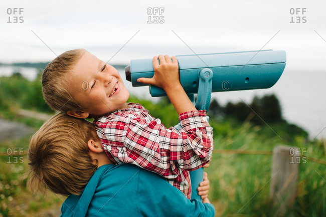 Side view of boys using telescope