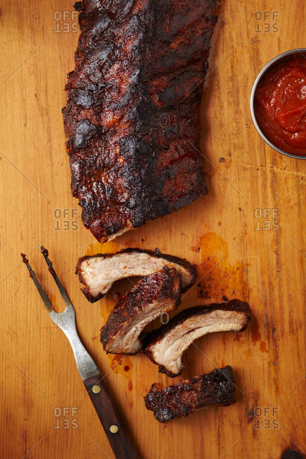Top view of spicy ribs on a wooden surface