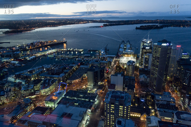 The neon lights of the Auckland city skyline covering Saint Mary's Bay.