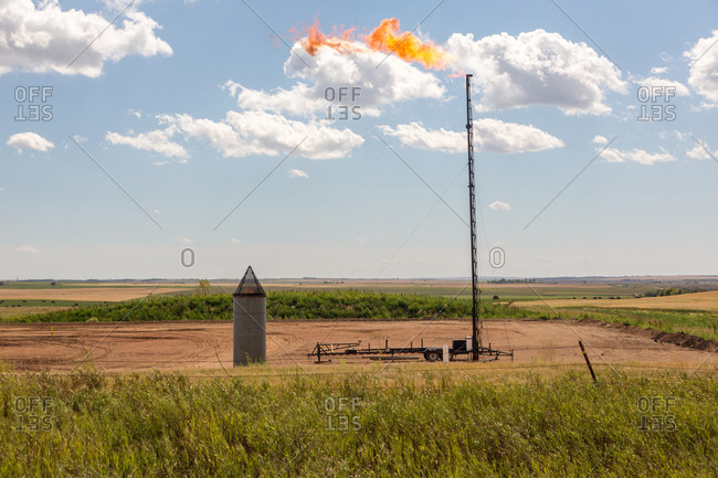 A controlled flame burns in the oil patch of northern North Dakota.