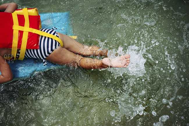Girl swimming with a swimming float