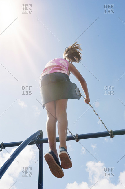 Low angle view of girl on a swing