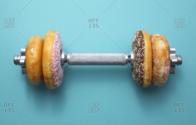Studio shot of a barbell with donuts