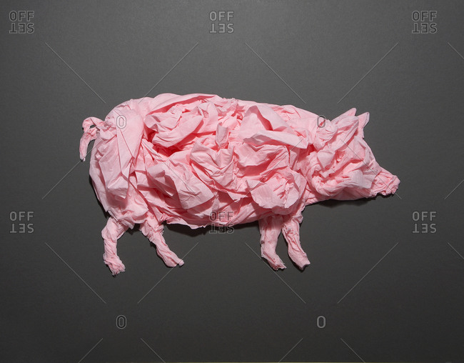 Crumpled pink tissue paper forms a pig
