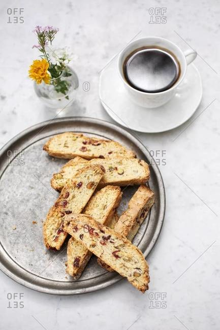 Sliced biscottis served with a cup of coffee