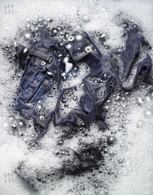 Jeans in soapy water