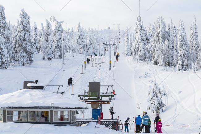 Skiers in Rukatunturi ski center, Lapland