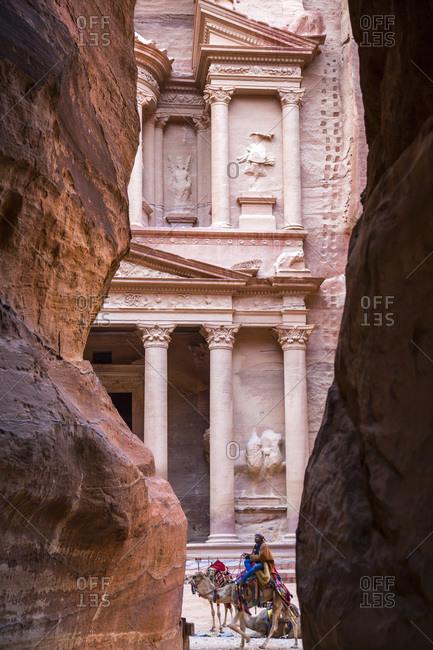 Petra, Jordan - January 21, 2014: The first glimpse of Petra's Treasury upon exiting the Siq, Petra, Jordan