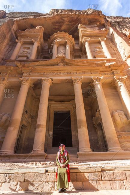 Petra, Jordan - January 21, 2014: Jordanian guard in front of The Treasury, Petra, Jordan