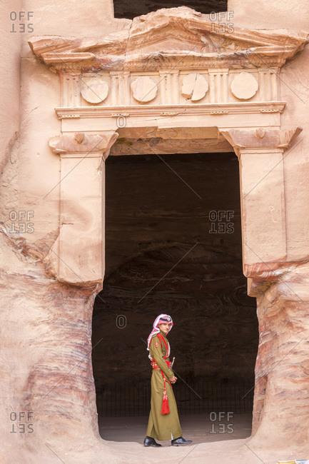 Petra, Jordan - January 21, 2014: Guard at entrance of tomb, Petra, Jordan
