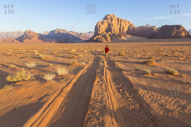 Man walking in the desert, Wadi Rum, Jordan