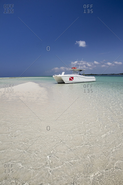 Boat originating from Deep Water Cay resort rests on a sand spit at the East end of Grand Bahama Island.