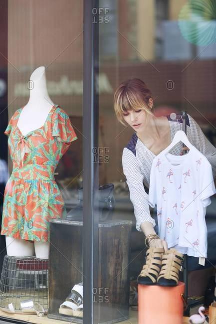 Woman arranging shop window