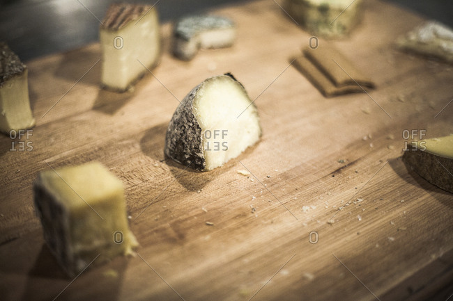 Various kinds of cheese on a cutting board