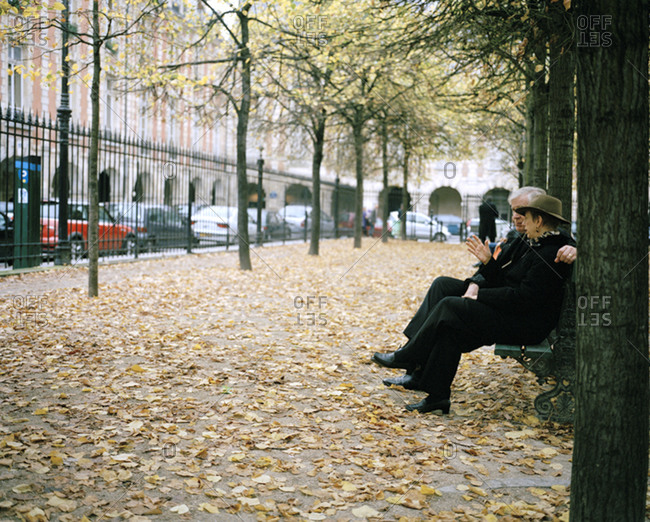 Paris - October 3, 2007: People sitting on a bench