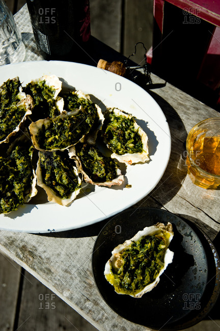 Close up of oysters rockefeller on oval-shape plate