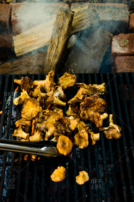 Close up of grilling freshly cut golden chanterelle