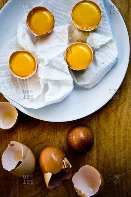Top view of egg yolks in shells for poaching