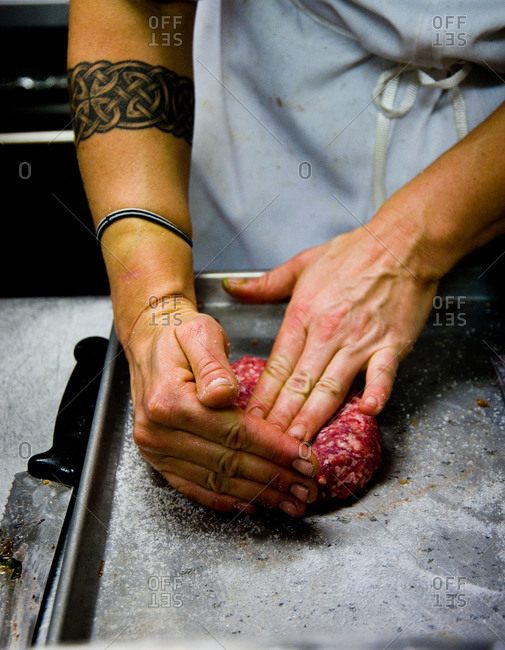 Person shaping a ground meat