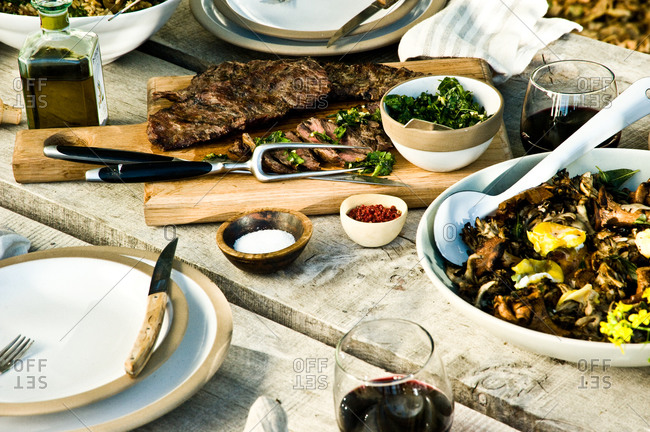 Grilled skirt steak and mushrooms served at a dinner party